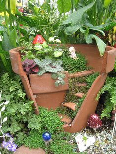Use a cracked terra-cotta pot to create a multilevel style with other pot pieces you can create stairs and other internal structures.