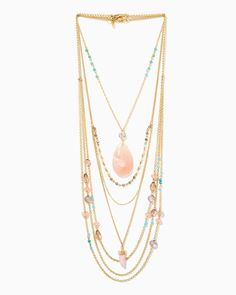 Adorn yourself with exquisite sparkle. Three multi-strand necklaces are bejeweled with a large marbleized pendant, shimmering pastel stones and elegant rhinestones, for a luxuriously layered look. Pair with a ruffled dress for an ultra-femme finish.