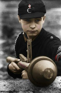 """A Hitler youth soldier with a Panzerfaust. ( - child of what? twelve?) """"Forgive them Lord for they know not what they do."""""""