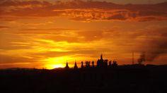 Panorama romano al tramonto con la Basilica di San Giovanni in Laterano in lontananza al tramonto. Photo: Paolo Di Pasquale
