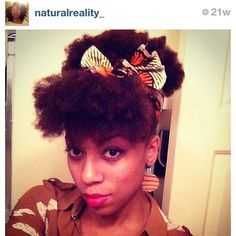 Natural hair - dyed and pined and put a ribbon on it.