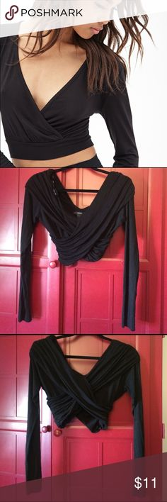 FOREVER 21 CRISS-CROSS CROP TOP Forever 21 criss-cross long sleeve crop top. Black. Criss-cross in front and back. Some loose strings. Good condition. Similar to first pic but a little different. Pic #2 is front. Pic #3 is back. Forever 21 Tops Crop Tops