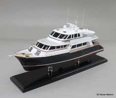 """Just off the workbench – 24"""" replica of a Marlow Explorer 72. If you can take a photo of your boat, you can have a model made of your boat - it's that simple! Our Specialty Is Custom Made Ship Models. Let us create a replica model of YOUR Boat Today."""