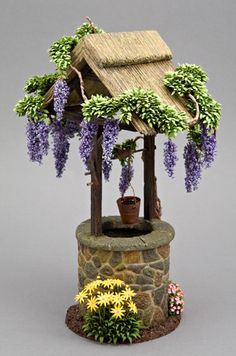 - Now that's a lovely fairy garden well. - DIY Fairy Gardens - Make a Wish! – Now that's a lovely fairy garden well. Fairytale Garden, Mini Fairy Garden, Fairy Garden Houses, Herb Garden, Fairy Village, Fairy Garden Furniture, Fairy Crafts, Twig Crafts, Garden Crafts