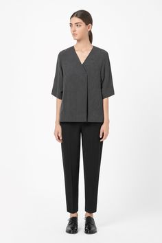 A subtle A-line shape, this loose-fitting top has a crossover front with a single pleat for easy volume. Made from a lightly textured fabric, it has a deep v-neckline, wide ¾ sleeves and cleanly finished edges.