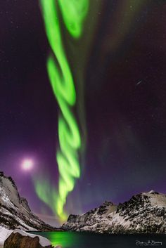 """Celestial Cyclone: """"Chasing storms across mid America during spring months now I am greeted by this 'Green Tornado' appearing aurora in Norway! Haunted by past storms even in Norway. Help me Toto!!"""" writes photographer Derek Burdeny. [1335 x 2000]"""