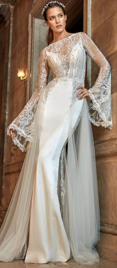 Body hugging mermaid dress with sheer peek-a-boo accents. Sheer trumpet sleeves and dreamy silk tulle overlay. It has a low open back, vintage embroidery with crystal accents. A wedding gown made with love from Galia Lahav. #marriage #wedding #dress