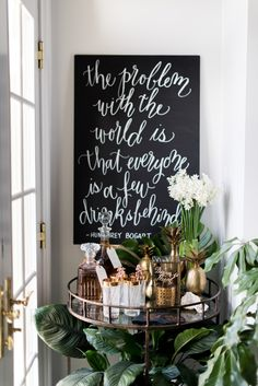 Tips for the perfect New Years Eve bar cart   Photography and styling: Sweet Root Village http://sweetrootvillage.com/   Calligraphy: Laura Hooper Calligraphy http://lhcalligraphy.com/