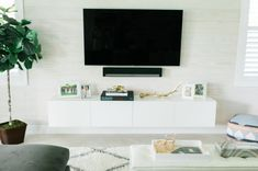 After our home tour on The Everygirl, I have been asked about my living room& IKEA Hack: DIY Floating TV Console. Floating Tv Stand Ikea, Tv Stand Ikea Hack, Floating Tv Console, Floating Cabinets, Floating Media Cabinet, Floating Tv Unit, Floating Shelves, Decor Home Living Room, Ikea Living Room