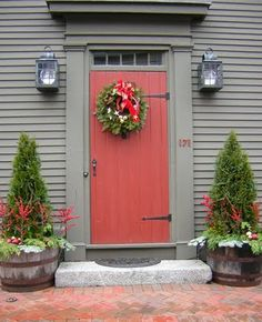 Cool Christmas door. (Like the house color combo)