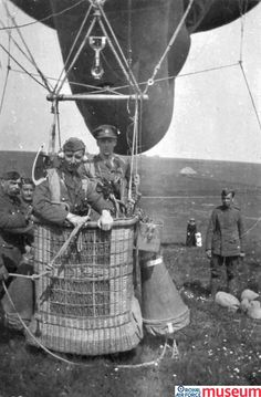 Observation balloon.    This is a photograph of an RFC Kite Balloon Observer standing in an anchored balloon basket. Kite balloons were used as observation posts, from which information was transmitted by telephone to artillery units on the ground. The balloons were a prime target and frequently attacked by 'balloon buster' aeroplane pilots.