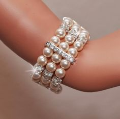 MADONNA Collection Rhinestone and Swarovski Pearl Bridal Cuff Bracelet Gorgeous Bracelet handmade with stunning rhinestones and Swarovski pearls Bracelet measures about wide Finished with secur Pearl Bracelet, Pearl Jewelry, Wedding Jewelry, Beaded Jewelry, Jewelry Bracelets, Unique Jewelry, Bridal Cuff, Wedding Bracelet, Pearl Bridal