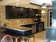 22 year old kitchen update, Updated kitchen by painting cabinets, adding wainscoting, crown and lower cabinet moldings, new laminate counter top and stainless appliances along with tumbled marble backsplash., Kitchens Design