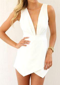 Blonde model wearing plunghing white skort romper