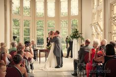 First kiss at Highcliffe Castle wedding ceremony. Photography by one thousand words wedding photographers