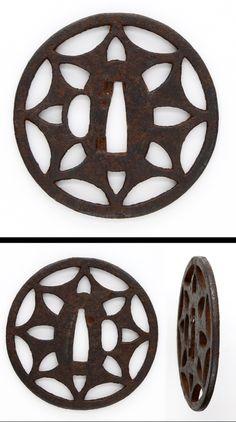 Edo Round shape iron tsuba with some open work.