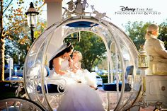 A Walt Disney World bride and her flower girl share a special moment together in Cinderella's Coach