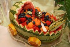 Gorgeous fruit arrangement of a baby's crib.