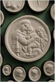 """Collection of moulds of engraved gems representing artworks and called """"Intaglios"""" : after the painting by Raphaël """"Madonna della seggiola"""", kept in the Palazzo Pitti, Firenze, Italy. Plaster Cast, Collections Of Objects, Oeuvre D'art, Oeuvres, Objet D'art, Grand Tour, Wax Seals, Architectural Elements, Sculptures"""