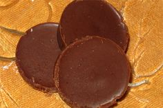 Coconut Chocolate Candy  1/2 cup coconut butter (coconut cream concentrate)  1/4 cup semi-sweet chocolate chips  2 T sugar Place ingredients in a double boiler or in a glass measuring cup in a pot of boiling water. Melt ingredients, continually whisking until smooth. Remove from heat and pour into silicone candy molds.