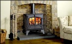 Woodburning stoves suppliers for Berkshire for the supply and installation of quality woodburning stoves such as this classical stone fireplace design and two door stove. Wood Stove Surround, Wood Stove Hearth, Slate Hearth, Fire Surround, Inglenook Fireplace, Stove Fireplace, Fireplace Design, Fireplaces, Fireplace Ideas
