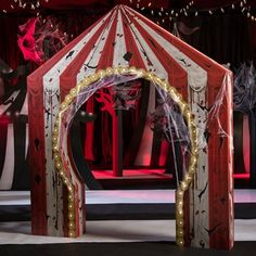 Add a Creepy Carnival Lighted Tent Arch to your event decorations. This freestanding cardboard archway puts a twist on the traditional carnival tent with a printed design that makes it look tattered and bloody. Scary Carnival, Carnival Tent, Carnival Lights, Haunted Carnival, Circus Carnival Party, Circus Theme Party, Scary Circus, Carnival Parties, Vintage Carnival