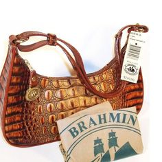 "Brahmin Venice Satchel This is a beautiful one-of-a-kind satchel. The color is toasted almond and it is a textured leather. Adjustable leather strap drop link is up to 21 inches. 11 x 3 x 7"" is the size of the purse. The person weighs 2.5 pounds. There is slight pen markings in the purse pricing will reflect. Brahmin Bags Satchels"