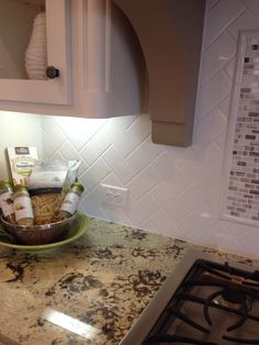Backsplash, level 2 granite, white cabinets