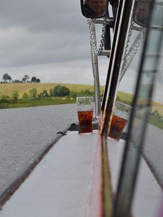 A boat, a half drunk glass of coke . . . . .