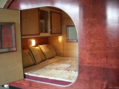 Bedroom in a teardrop trailer.  Traveling with a bed & kitchen, who needs hotels?