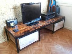 Scrap wood and steel TV stand. I made it a few years ago but it looks very nice in my new apartment.