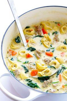This Creamy Tortellini Soup With Italian Sausage Is An Absolute Winner. It's Made With A Rich And Creamy Broth Made Without Heavy Cream, Cheesy Tortellini, Zesty Italian Sausage, And Lots Of Greens And Veggies. All out, Delicious Comfort Food Creamy Tortellini Soup, Sausage Tortellini Soup, Italian Sausage Soup, Tortellini Crockpot, Soup Recipes, Cooking Recipes, Healthy Recipes, Healthy Snacks, Healthy Soup