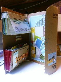 Road Book from Amazon packaging - could decorate the cover & add pockets instead of the accordion file & a pen holder