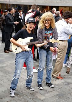 Kathie Lee Gifford and Hoda Kotb as Wayne and Garth