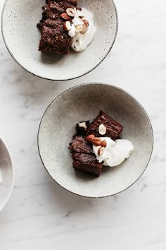 double chocOlate brownie with whipped creme fraîche cream and toasted hazelnuts