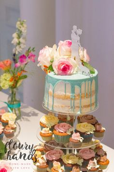 semi-naked wedding cake drip with roses and cupcakes 2