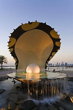 Pearl Monument on the Corniche of Doha Bay with the central business district of…