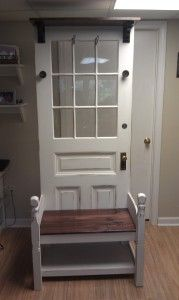 Nice looking hall tree made from an old door and a headboard. I like the contrast of the paint with the stained wood. Good design choices!