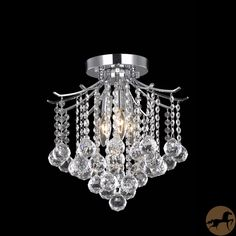 Illuminate your dining room and impress your dinner guests with this contemporary crystal three-light chrome chandelier featuring a series of beautiful crystal shades. The flush mount means it will look great regardless of ceiling height.