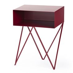 The Robot side table features an open shelf on zig zag legs. A minimal design made in solid steel, powder coated in a variety of colours. Beetroot red table.