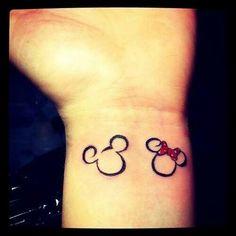 Mickey and Minnie tattoos.