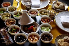 I don't care what they say about French Cuisine, if you haven't had REAL Moroccan food, you don't know what  you're missing!  Yummy Tagine with a typical Moroccan salad assortment. #Moroccan #Cuisine.
