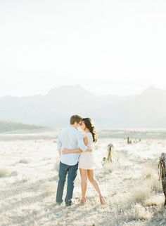 Couple with an interlocking embrace in the desert