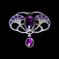 LEVINGER & BISSINGER  A silver, plique-a-jour brooch set with a central amethyst, with an amethyst drop. German c.1900. Maker's mark '900' and 'DEPOSE'. Size: Height 3.2 cm. Width 3.3 cm.