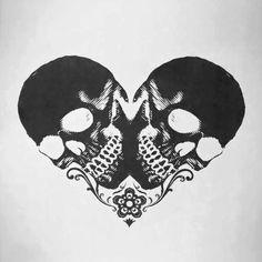 Skulls heart tattoo