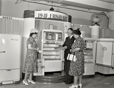 "July 1941. ""Detroit, Michigan. Buying a refrigerator at the Crowley-Milner department store."" Here we see Mr. Salesman explaining the ice maker, which employs a ""tray."" Large-format negative by Arthur S. Siegel"
