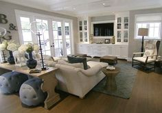 Love this look..rug..table behind couch..TV and shelves