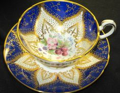 PARAGON GOLD FRUIT FLOWERS STAR TEA CUP AND SAUCER COBALT STRAWBERRY
