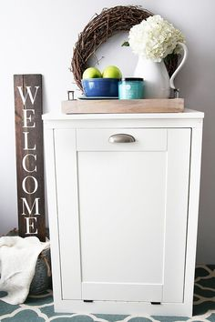 How to Build a Custom TiltOut Trash Cabinet is part of cabinet Ideas Trash Bins - This custom tiltout trash cabinet is awesome for hiding ugly trash cans and can be customized to match your kitchen! Hide Trash Cans, Trash Bins, Diy Cabinets, Custom Cabinets, Hidden Trash Can Kitchen, Wooden Trash Can Holder, Trash Can Cabinet, Garbage Can, Diy Kitchen