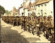 Survivors: Soldiers of the original British Expeditionary Force return from the bloody battle of Loos in Sep 1915. Loos was the last in a series of failed British attacks that effectively destroyed the BEF and led to the firing of its commander, Sir John French, and the hiring of his successor, Sir Douglas Haig - Colourised by British photo technician Frank Augrandjean from the Imperial War Museum's archive IWM